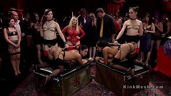 Group of sexy slaves serving at kink ball